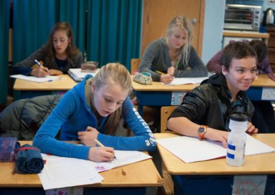 Students work on their main lesson books in the morning each day.