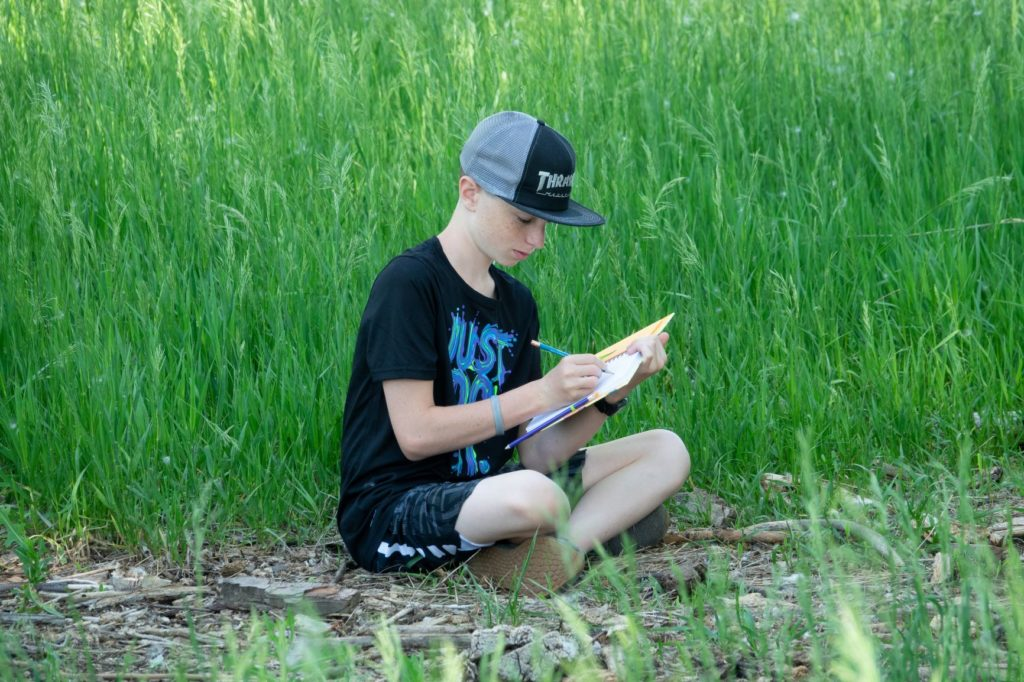 Students often spend time outside reading, writing, or drawing on Boulder Valley Waldorf's 38 acres campus.